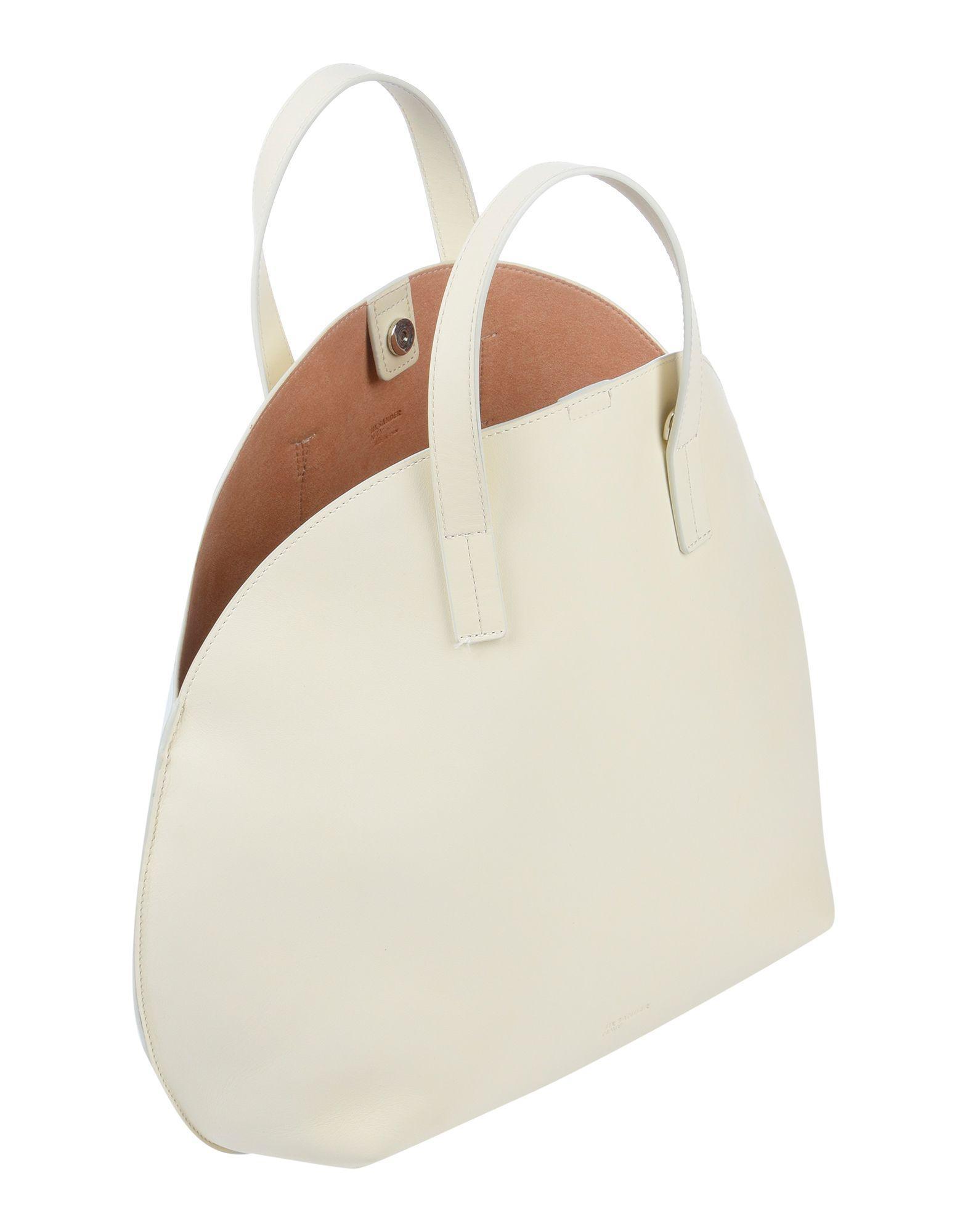 Jil Sander Navy Handtaschen in Weiß MOXyr