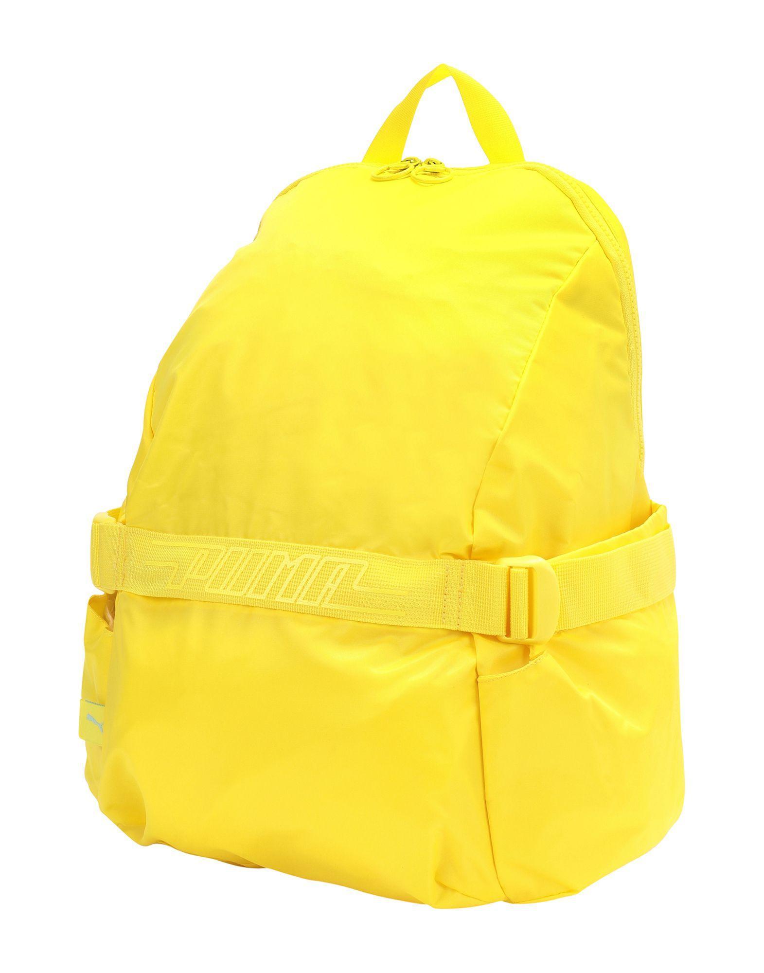 mochila puma amarilla