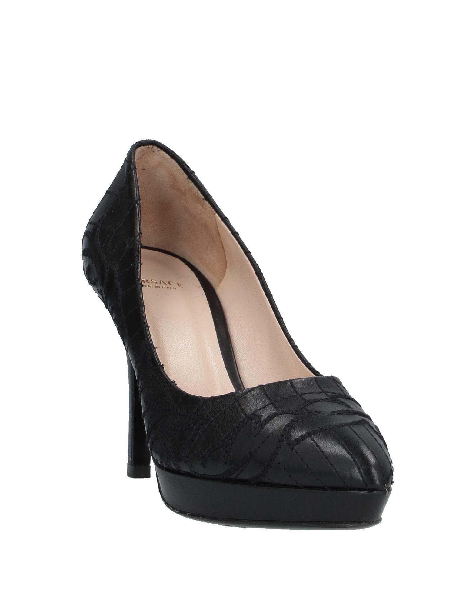 Zapatos de salón Versace de Cuero de color Negro