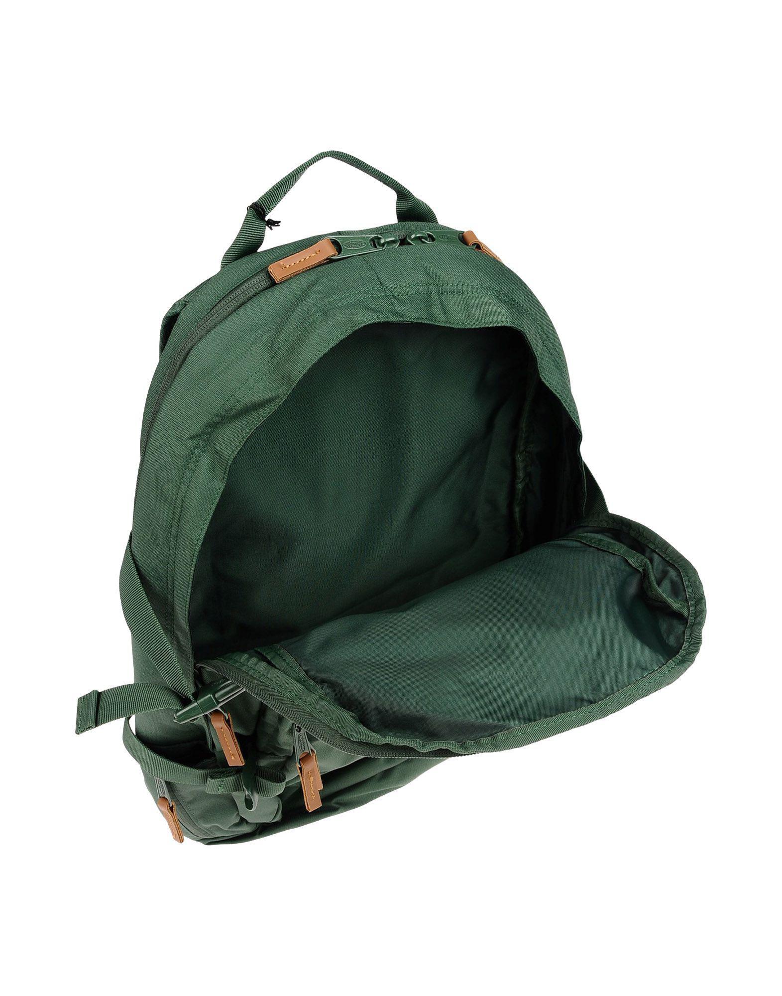 Eastpak Canvas Backpacks & Fanny Packs in Green