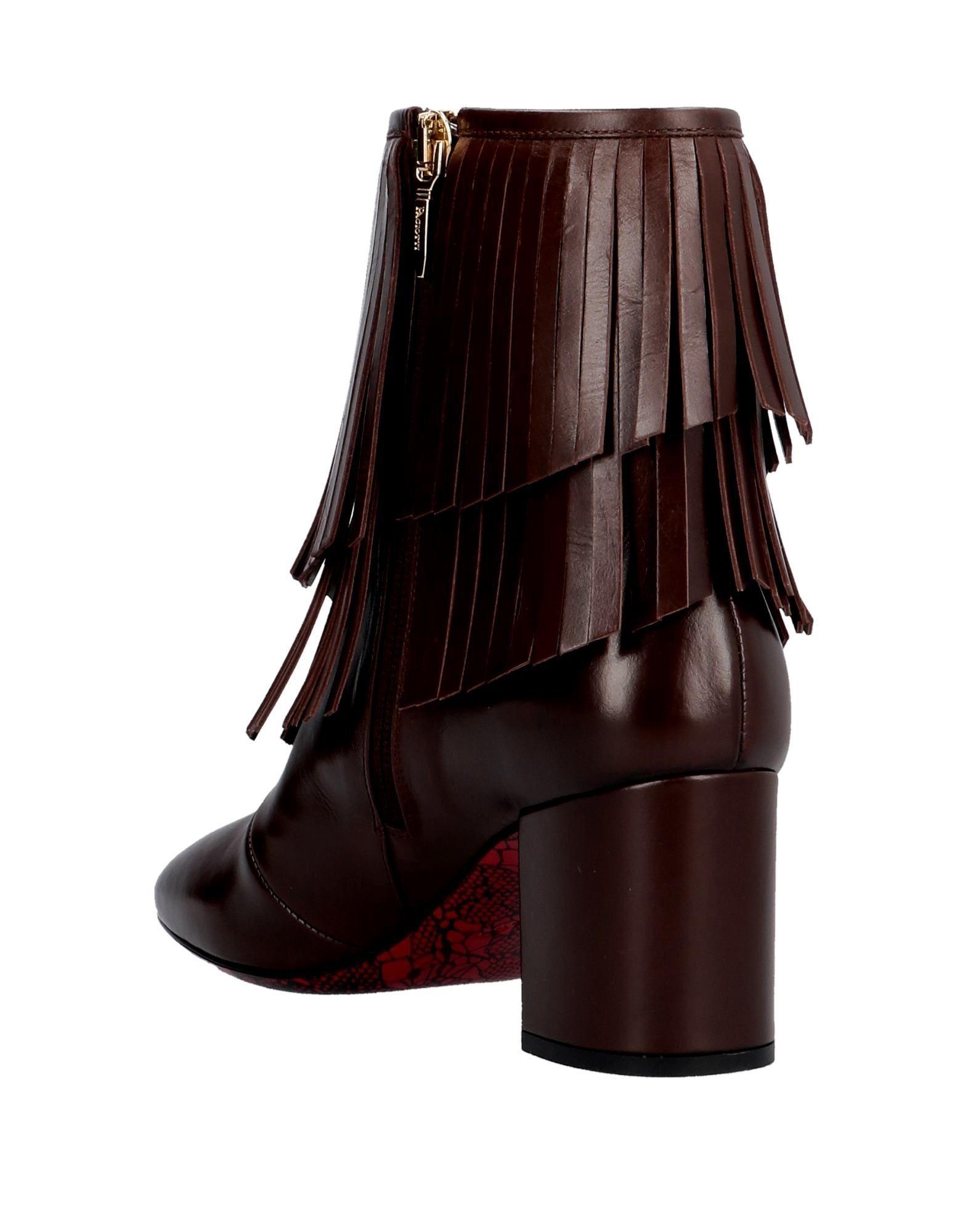 Botines de caña alta Cesare Paciotti de Cuero de color Marrón