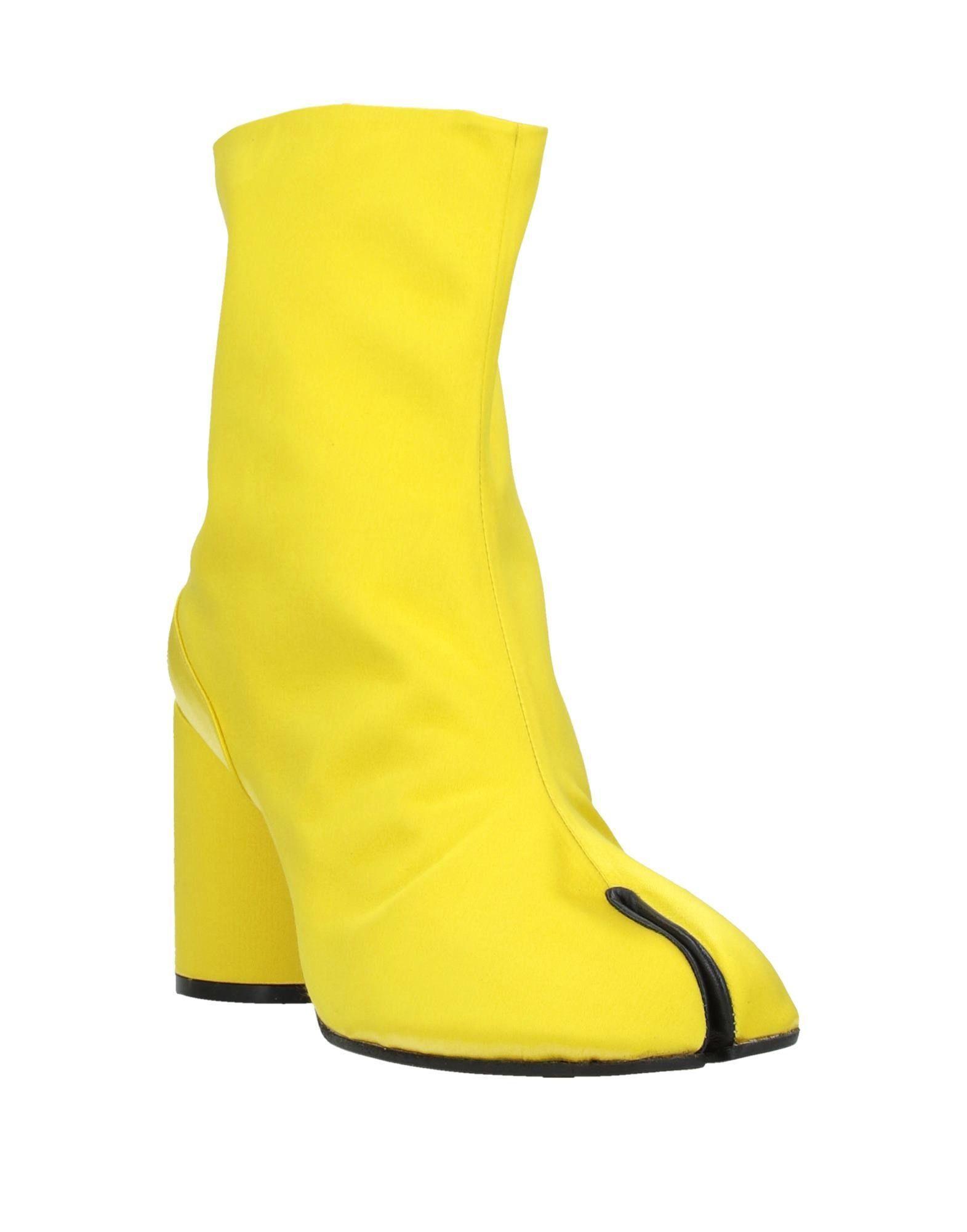 Botines de caña alta Maison Margiela de Raso de color Amarillo