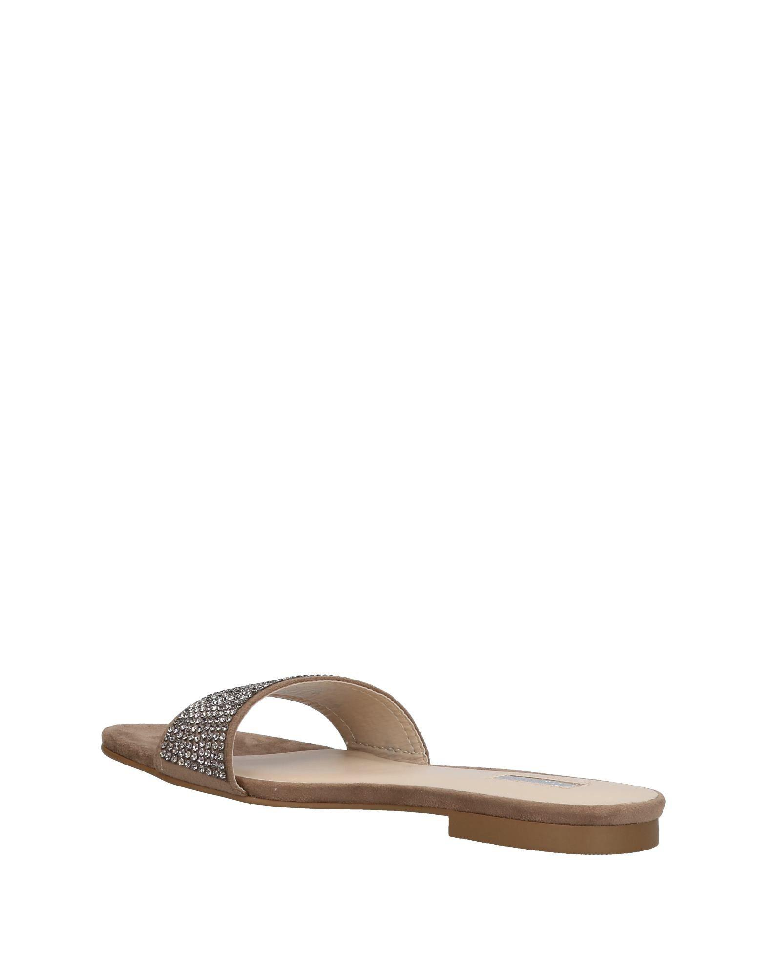 09d6ded3a808 Lyst - Guess Sandals