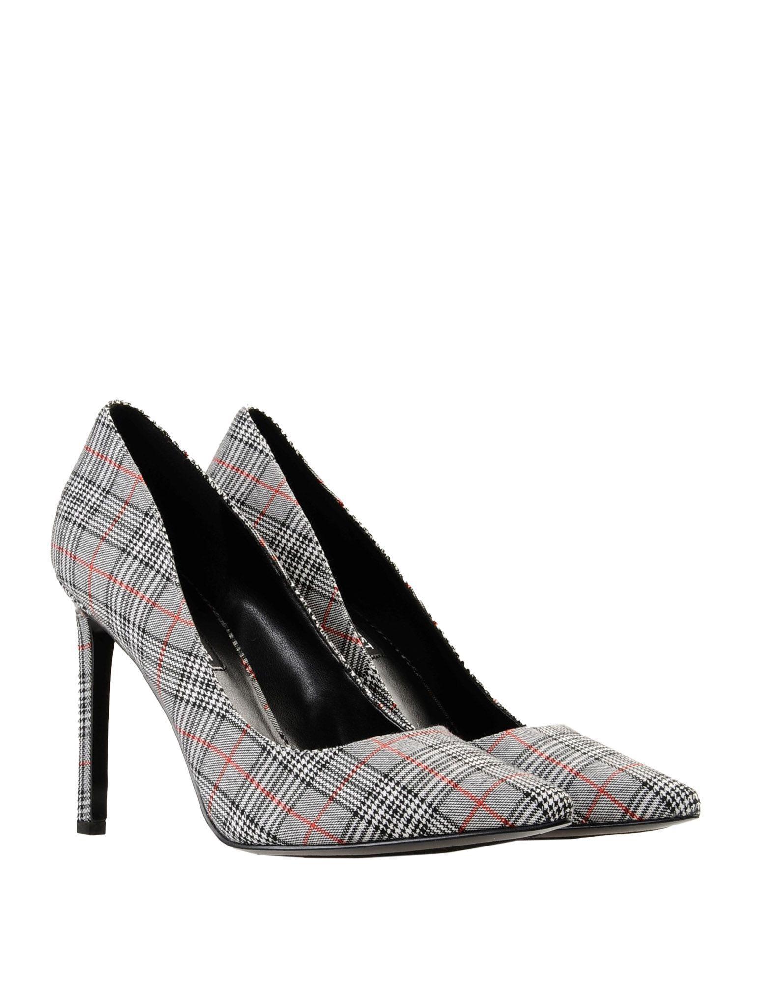 Zapatos de salón Nine West de color Negro