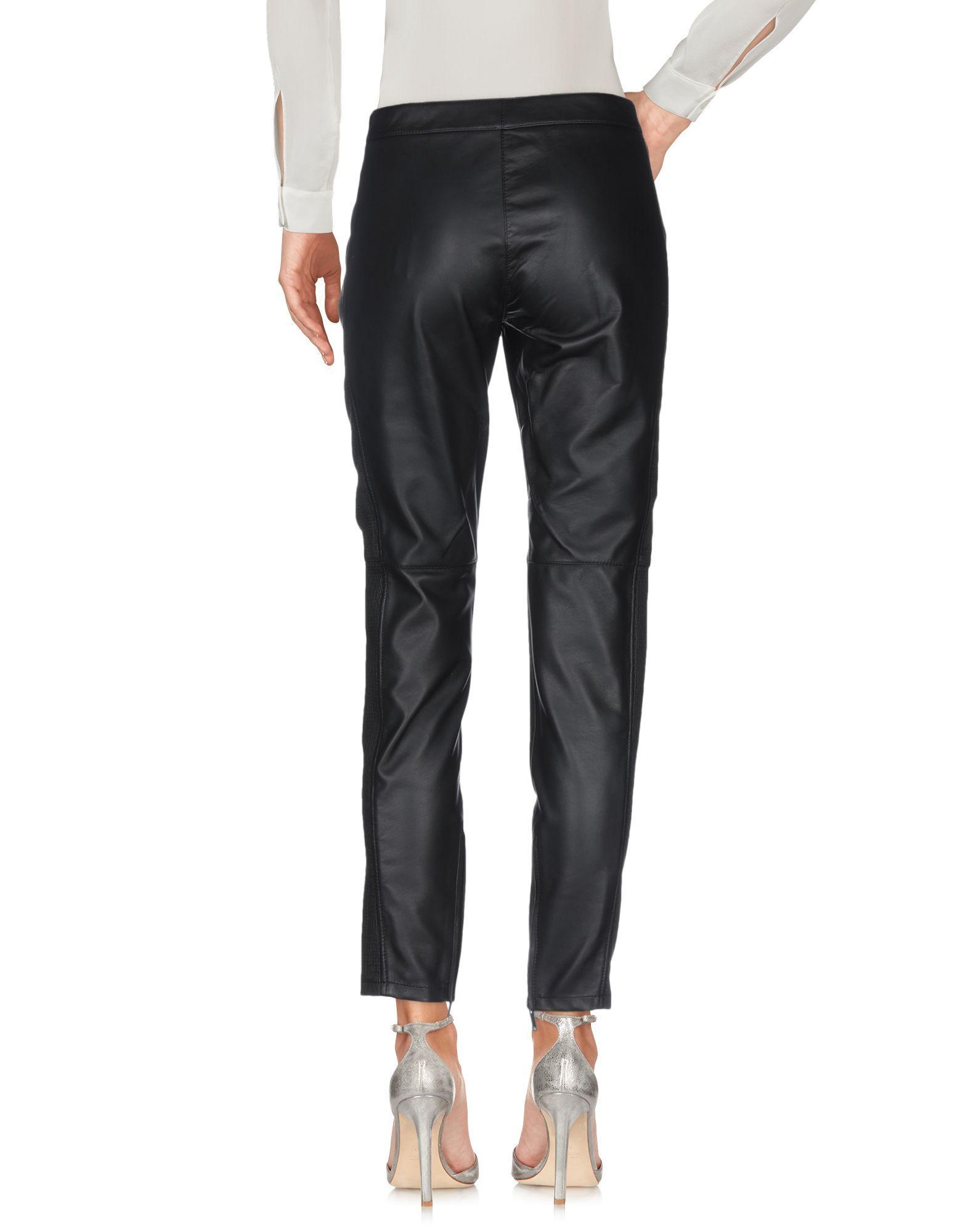Pantalones Burberry de color Negro