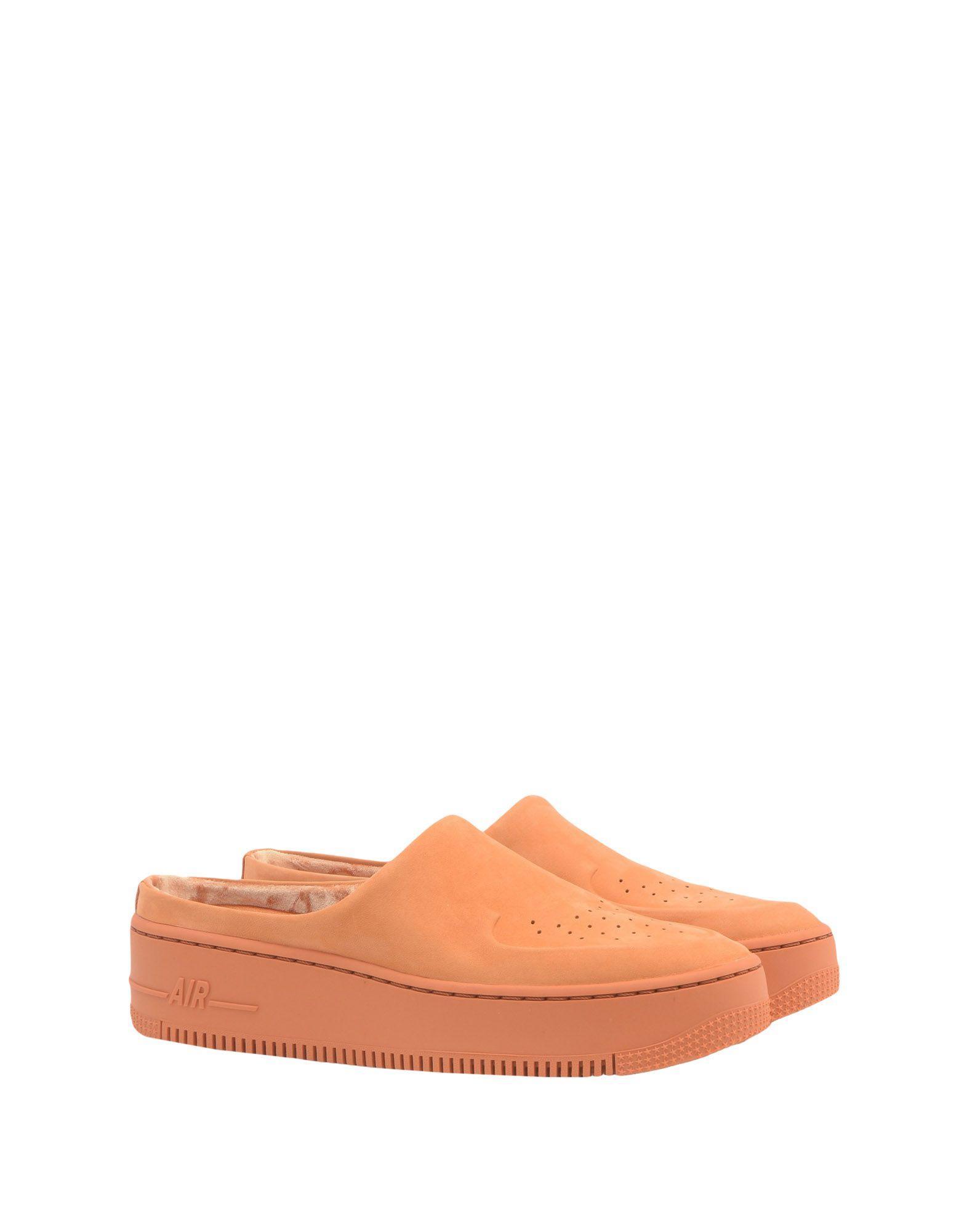Nike Leather Mules in Orange