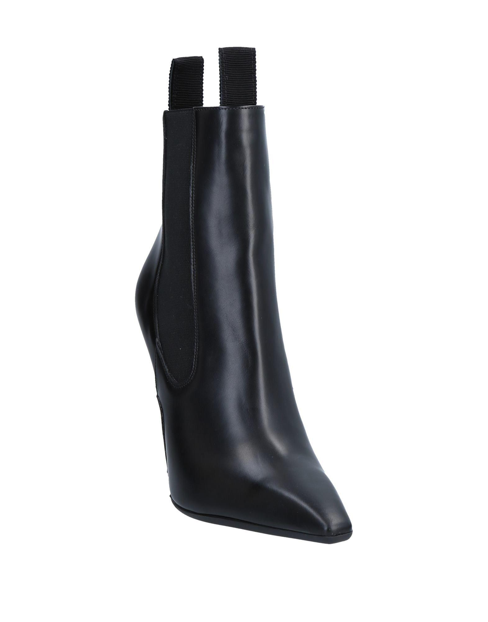 Botines de caña alta Versace de Cuero de color Negro