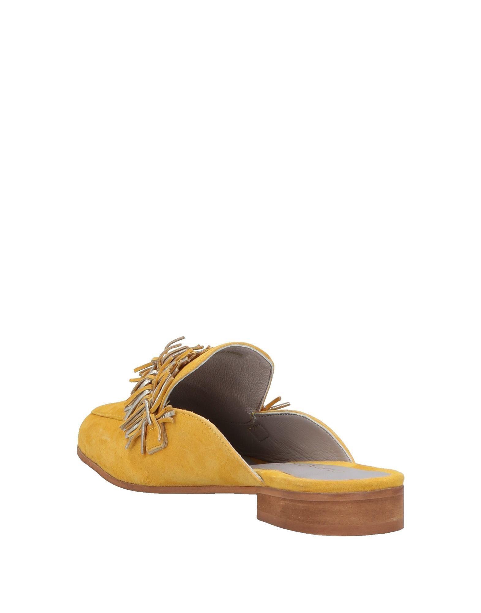 Mules & Zuecos CafeNoir de Ante de color Amarillo