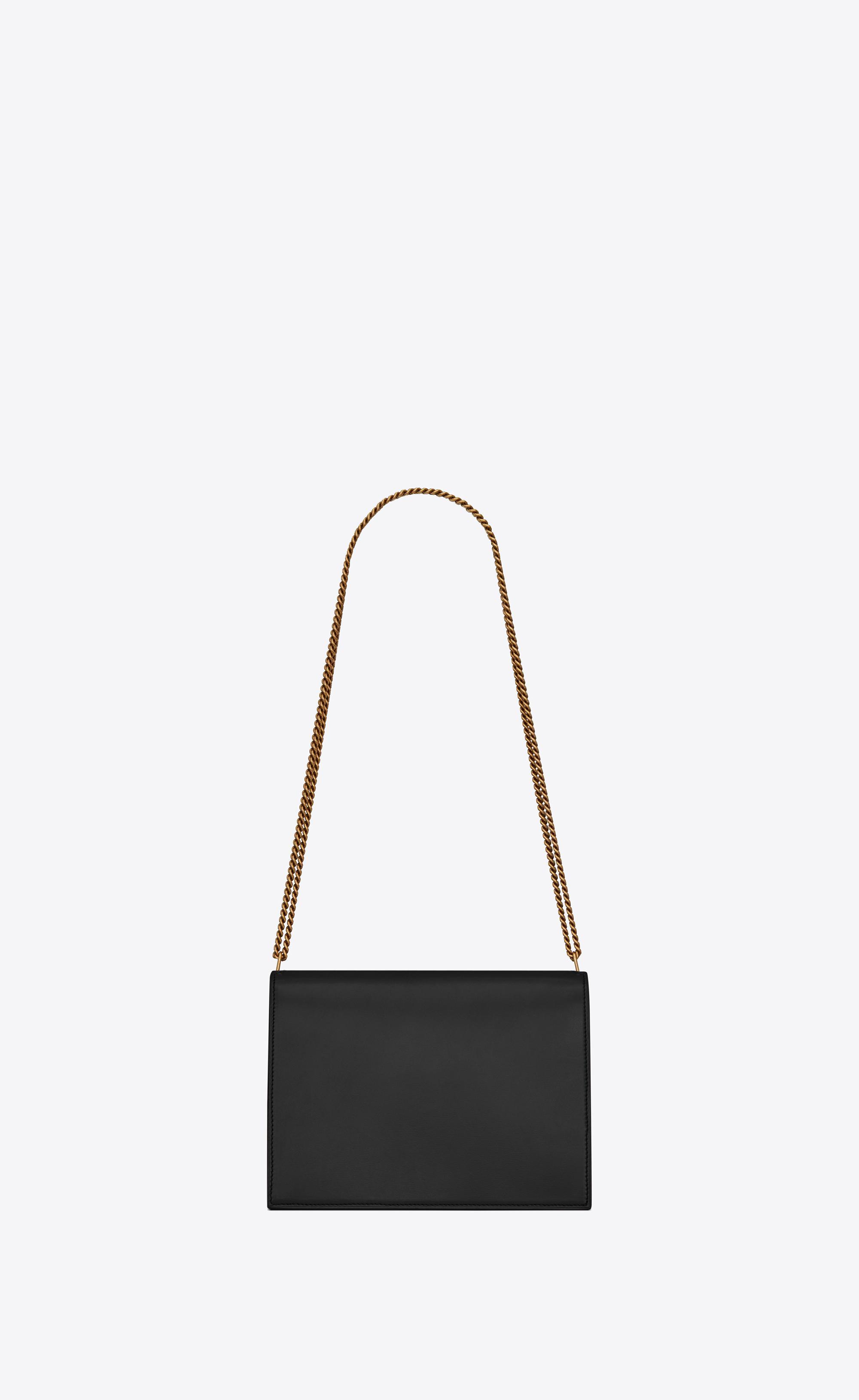Saint Laurent - Black Cassandra Monogram Clasp Bag In Smooth Leather -  Lyst. View fullscreen 908c2ad498cc8