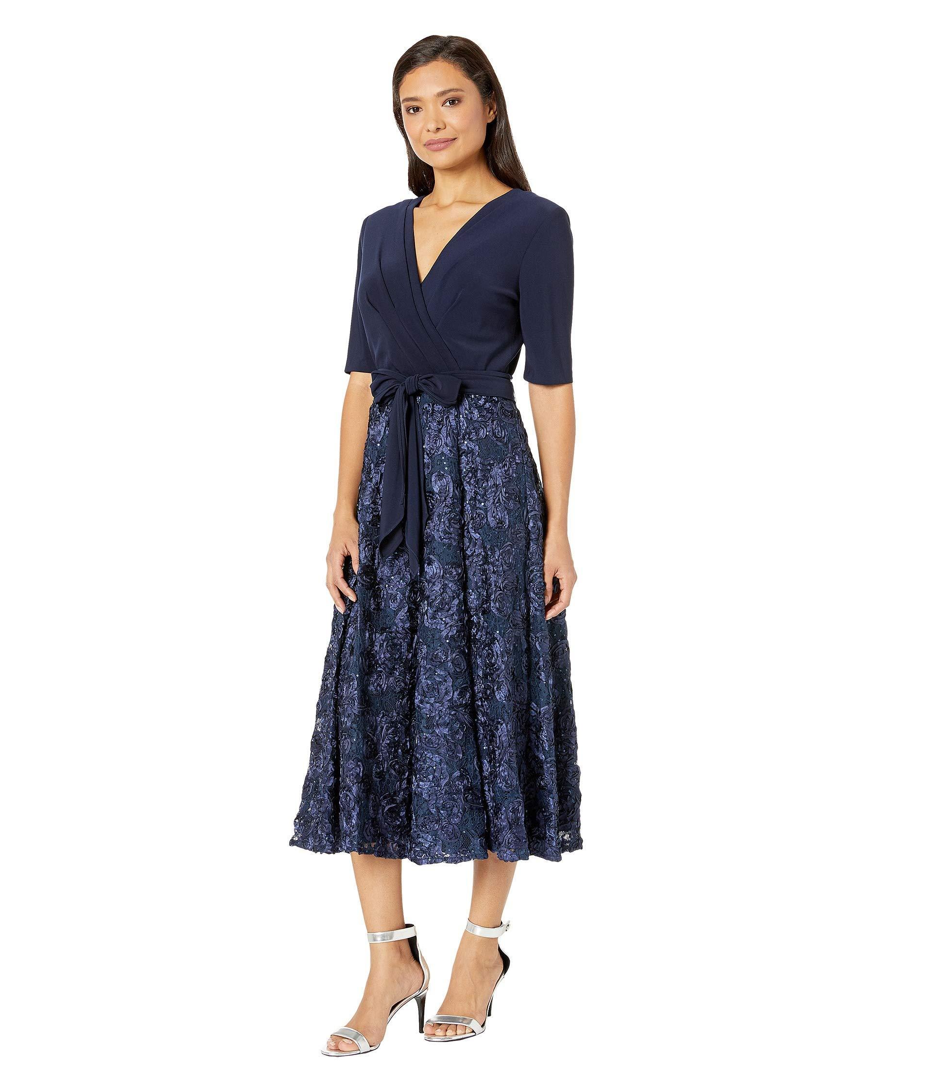 e2158dca4e7e Tap to visit site. Alex Evenings - Blue Tea Length Party Dress With Full  Rosette Skirt ...
