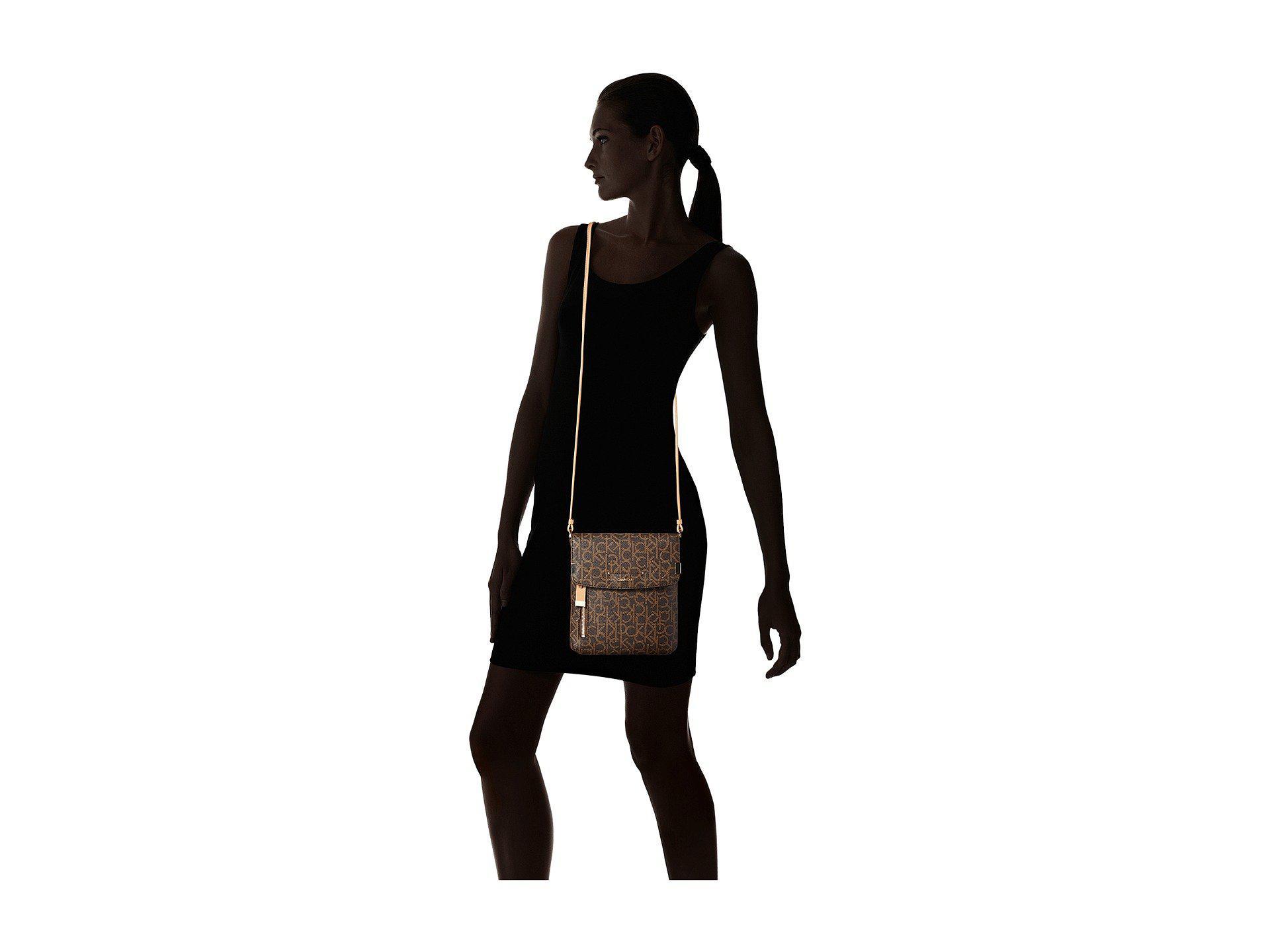 Calvin Klein Brown Raelynn Monogram Crossbody Cream Cross Body Handbags Lyst View Fullscreen
