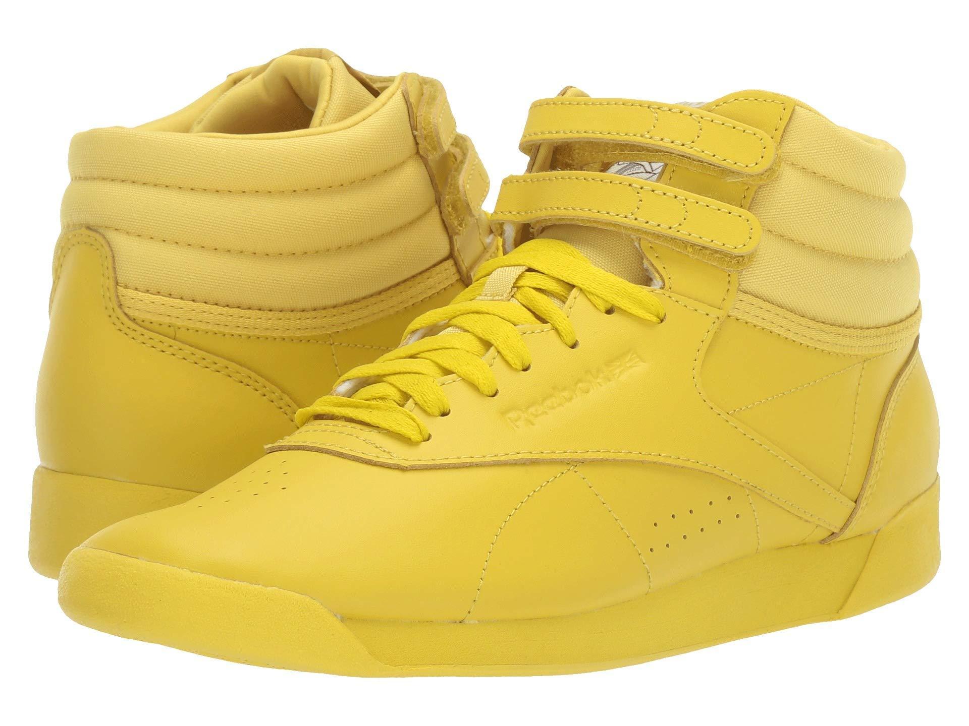 Reebok Leather Freestyle Hi in Yellow
