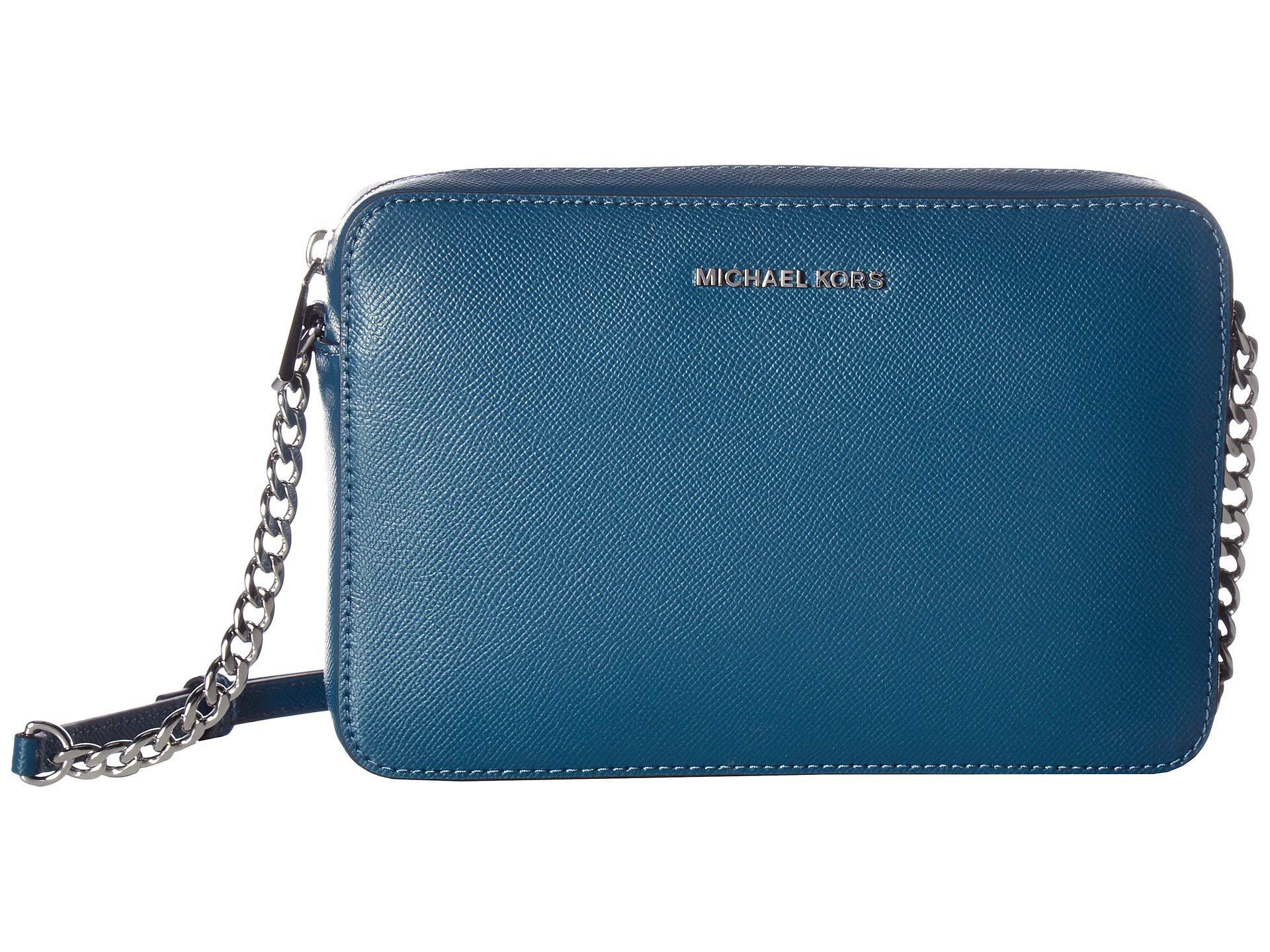 733628ac39e0 MICHAEL Michael Kors. Women s Blue Jet Set Travel Large East west Crossbody  (pearl Grey) Cross Body Handbags
