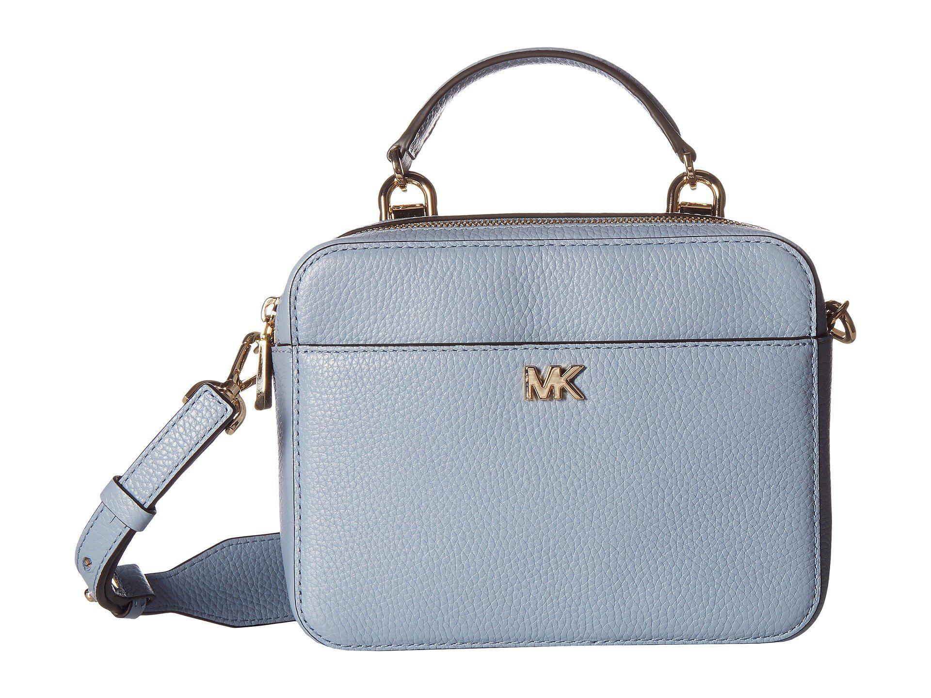 a3aa82062ced MICHAEL Michael Kors. Women s Blue Medium Guitar Strap Crossbody (black)  Handbags