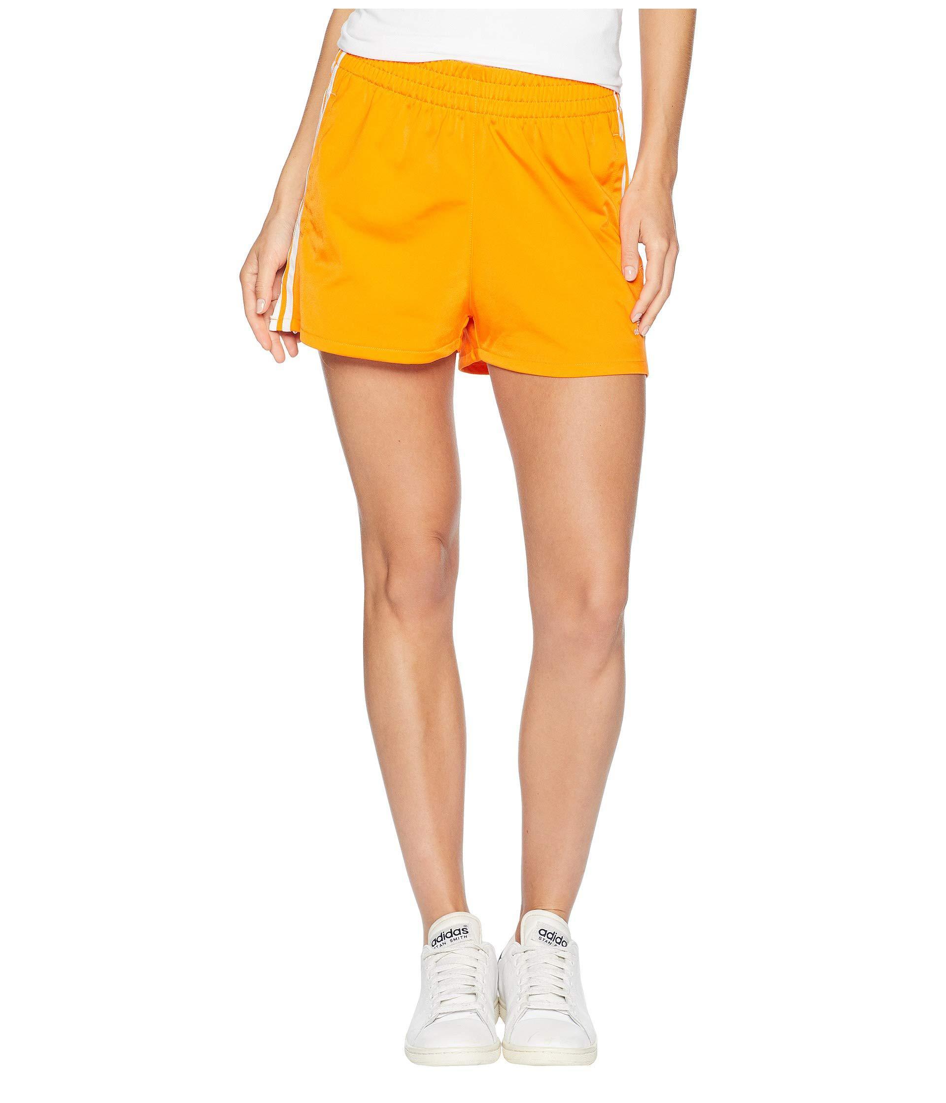 adidas shorts in orange