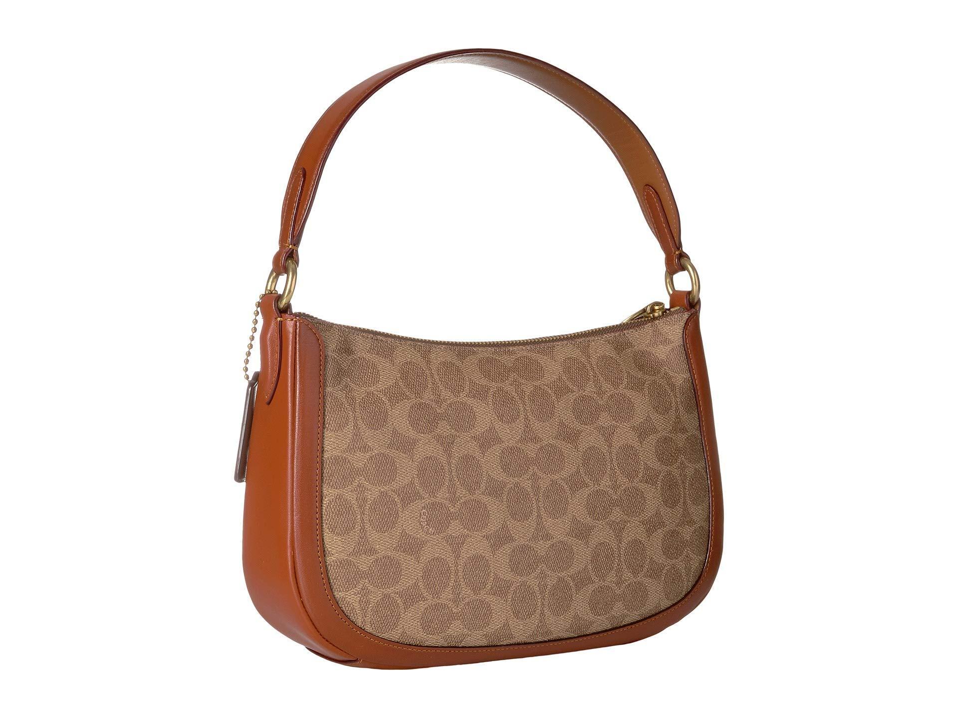 COACH - Brown Coated Canvas Signatures Sutton Crossbody (tan rust brass)  Handbags. View fullscreen a1f499fcdeacb