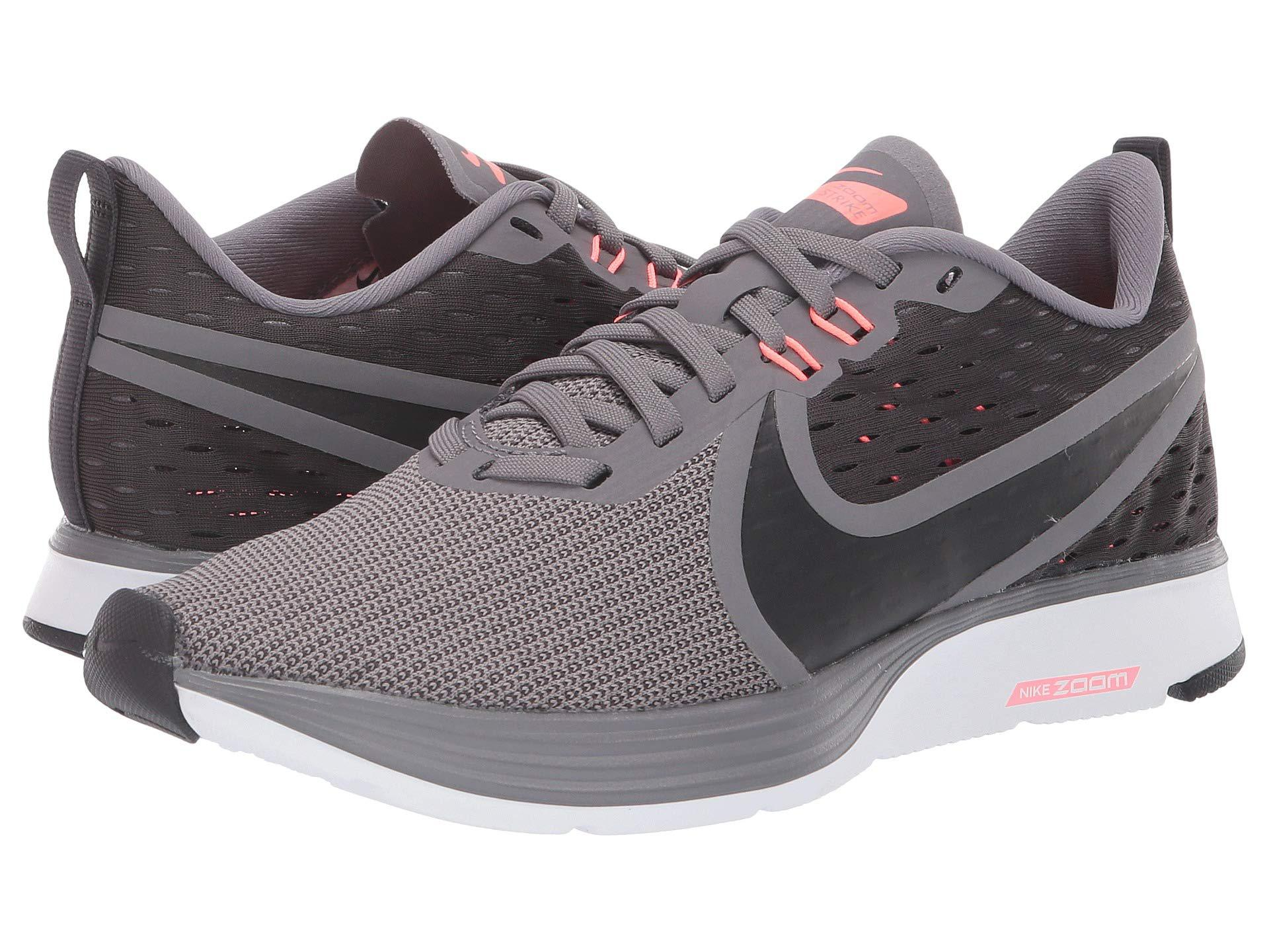 053f82af3900 Nike. Gray Zoom Strike 2 (gunsmoke oil Grey lava Glow white) Women s  Running Shoes