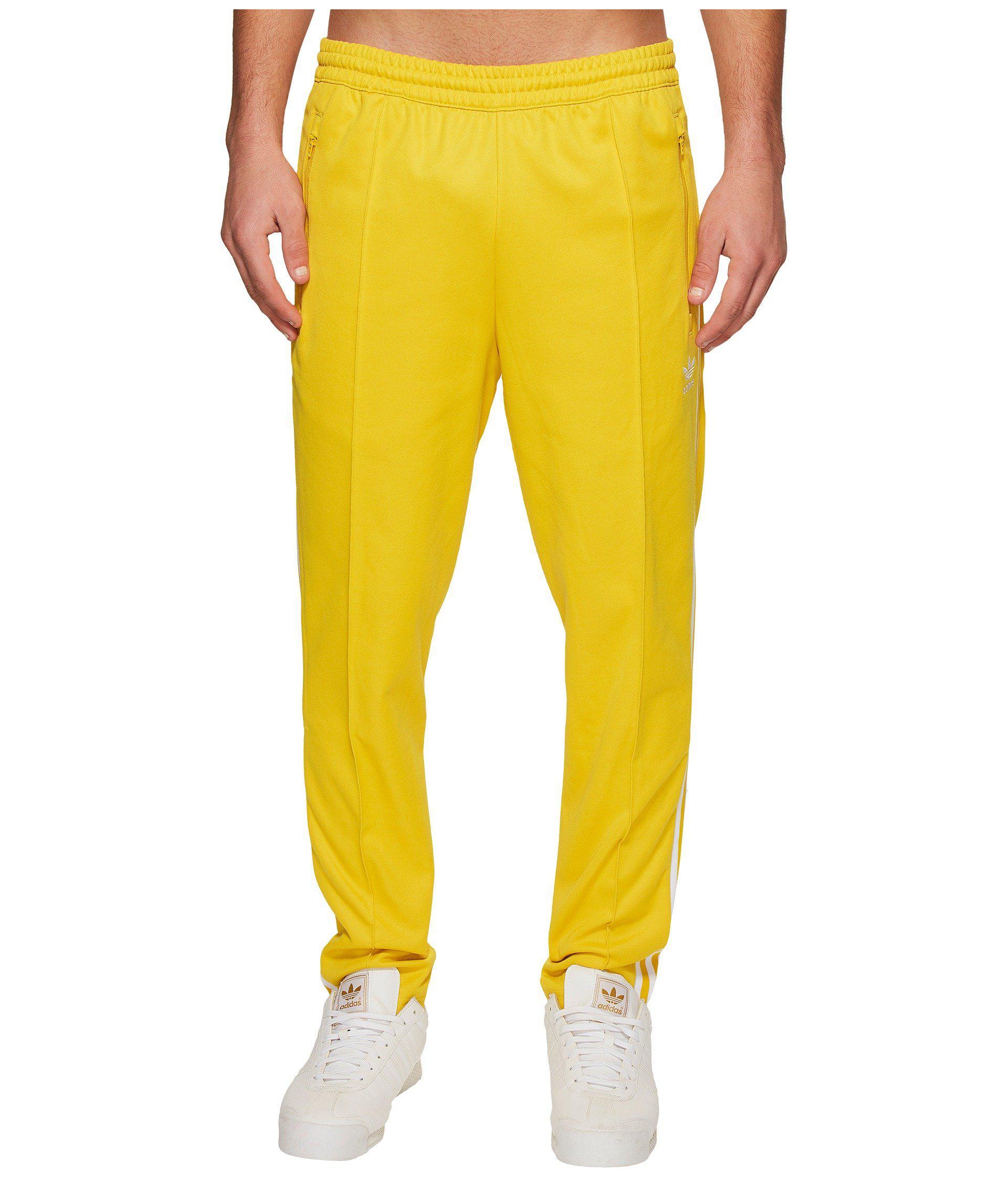 adidas beckenbauer yellow pants