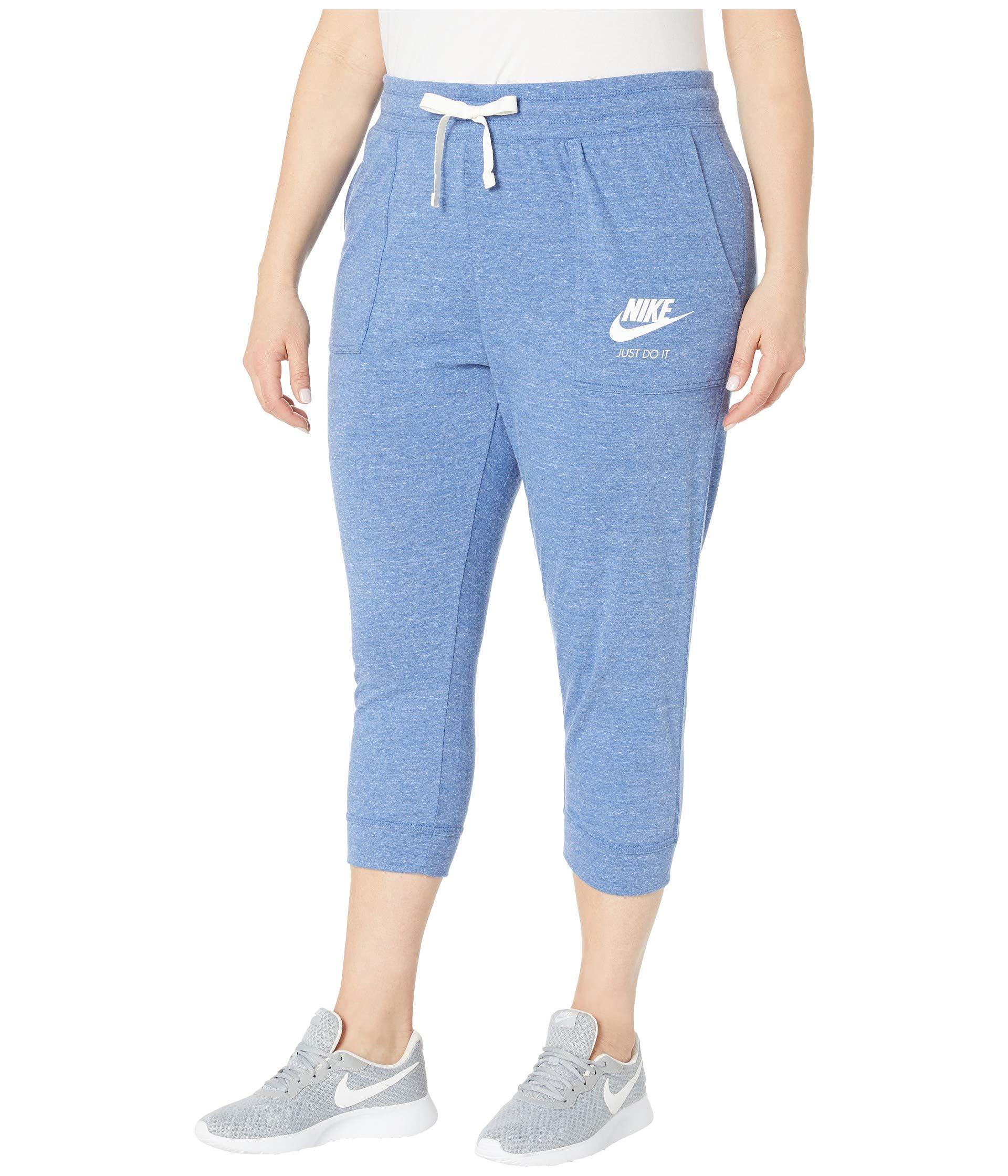 67b43afe41d3 Lyst - Nike Plus Size Gym Vintage Extended Capris (indigo Storm sail)  Women s Casual Pants in Blue